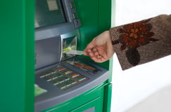 Feminine hand with credit card. And green bank terminal stock photo