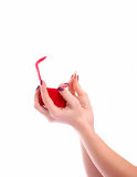 Feminine hand holding a red box with gold ring Royalty Free Stock Image