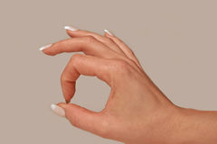 Feminine Hand OK Gesture Stock Images