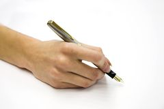 Feminine hand with pen. On white background Royalty Free Stock Images