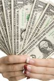 Feminine hands holding money Royalty Free Stock Photo