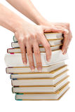 Feminine hands keeps pile of the books Royalty Free Stock Photography