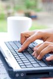 Feminine hands on laptop Royalty Free Stock Image