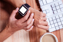 Feminine hands with smartwatch and coffee Royalty Free Stock Photography