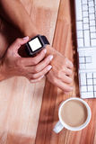 Feminine hands with smartwatch and coffee Stock Photography