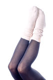 Feminine legs with colored tights Stock Image