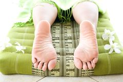 Feminine legs on massage bed Stock Photo