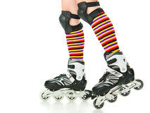 Feminine legs with roller skates Royalty Free Stock Photo