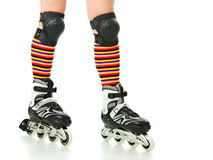 Feminine legs with roller skates Stock Photography