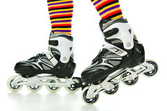 Feminine legs with roller skates Stock Photos