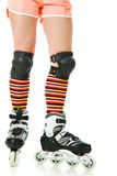 Feminine legs with roller skates Royalty Free Stock Photos