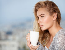 Feminine nice girl with a tea cup stock photography