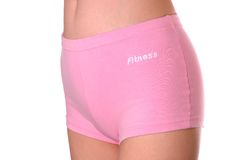 Feminine pink shorts frontal. Sports feminine pink shorts on white background Stock Photo