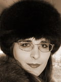 Feminine portrait. The portrait of the russian girl, winter, sepia Royalty Free Stock Images