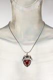 Feminine romantic necklace. With heart shaped pendant Royalty Free Stock Photos
