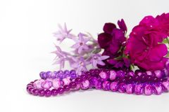 Feminine and romantic pearls flowers and accessories in ultraviolet year tone royalty free stock image