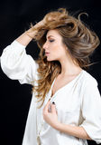 Feminine sensitive emotional woman in silk in the studio Stock Photography