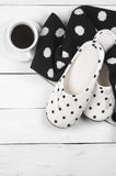 Feminine slippers, knitwear and coffee Royalty Free Stock Photography