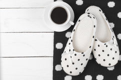 Feminine slippers, knitwear and coffee Royalty Free Stock Images