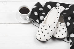 Feminine slippers, knitwear and coffee Royalty Free Stock Image
