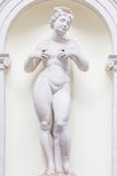 Feminine statue of Abundance. 300 years old statue of Abundance in an Italian park, no need of release Stock Photos