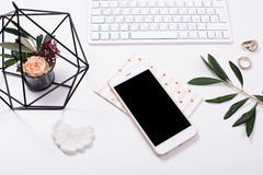 Feminine tabletop flatlay with smartphone mock-up. White feminine tabletop flatlay with smartphone mock-up. Home office decor objects Stock Photos