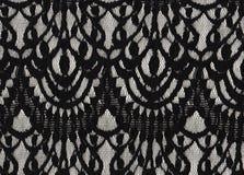 Feminine Black lace on white background. royalty free stock images