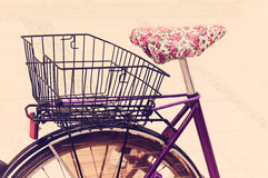 Feminine vintage bicycle with basket. Feminine vintage purple bicycle with basket Stock Images