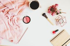 Feminine winter table, woman fashion clothes and make up, sketch book and coffee. Seasonal set on white background stock photography