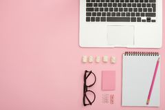 Free Feminine Work Desk Of Orderly Person With Laptop, Glasses, Jotte Royalty Free Stock Image - 122241616