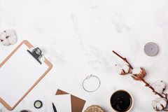 Feminine workplace with coffee and cotton buds Stock Image