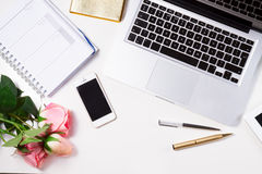 Feminine workspace, top view. Feminine workspace with laptop, notebbok and phone, top view Stock Photos