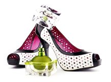 Femininity accessories. Perfumes and Shoes. Femininity accessories on a white background royalty free stock images