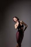 Femininity. Elegant Daydreaming Woman posing in Studio over Grey Background Stock Photos