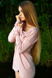 Femininity girl teenager with luxurious long hair. Outdoors Royalty Free Stock Photography