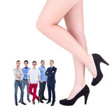 Feminism concept - giant female legs and little business men iso Stock Images