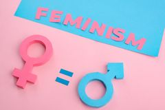 Feminism and gender equality. Feminism and gender signs. Equality between men and women. 3D paper art, social politics concept royalty free stock image