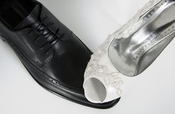 Feminist equality wedding bride shoes details groom. Bride and groom wedding details Stock Photos