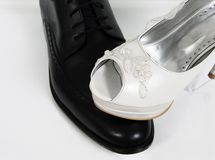 Feminist equality wedding bride shoes details groom ceremony Stock Photos