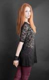 Feminity. The slim sensual girl in a black dress royalty free stock image