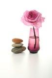 Feminity,ambiance zen. Feminity and zen atmosphere, rose and rocks stock photo