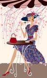 Femme à un café Image stock