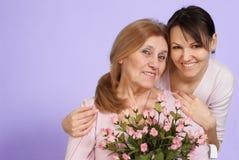 Femme âgée caucasienne de chance et son descendant Photographie stock