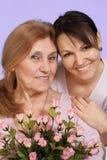 Femme âgée caucasienne de joie et son descendant Photographie stock