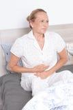 Femme âgée en douleur Images stock
