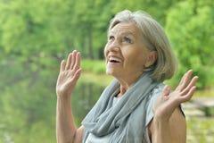 Femme âgée songeuse Images stock