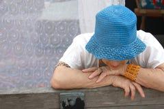 Femme âgée triste Photo stock