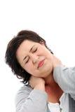 Femme étirant son cou raide images stock