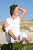 Femme aîné à la plage Images stock