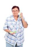 Femme aîné au téléphone Image libre de droits